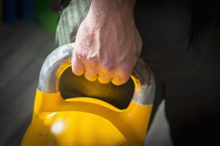 yellow kettlebell gym Stock fotó