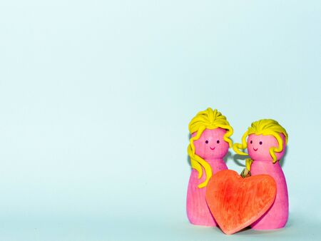 a wooden couple on a customizable background for wedding anniversary or saint valentine day