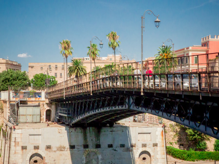 the taranto swing bridge on the taranto canalboat that separates the big sea from the little sea Banco de Imagens