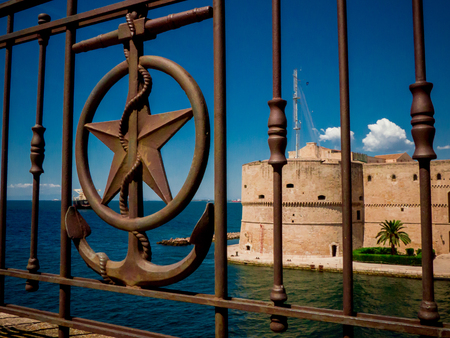 the railing on the waterfront of the city of   taranto, in the south of italy, in front of the aragonian castle on the sea
