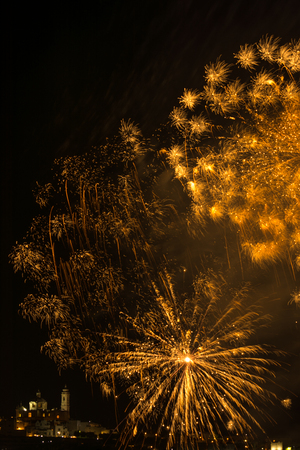 saint: fireworks in the sky over the city of Locorotondo, in the south of italy, during the celebrations of saint rocco Stock Photo