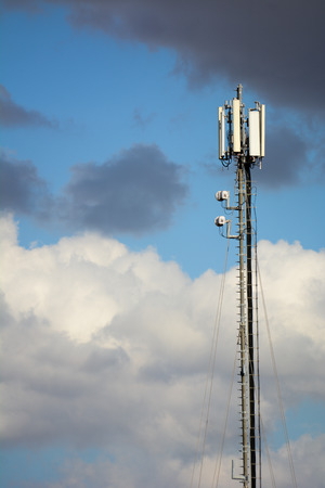 a cellphone antenna on a cloudy sky background