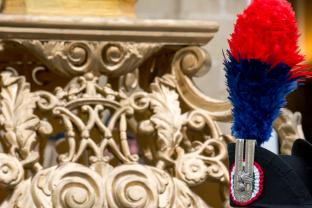 the tassel of a italian carabineer high uniform on blur background during a catholic celebration