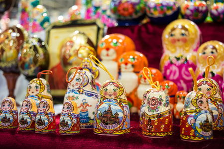 colored matrioskas at the russian shop on blur background