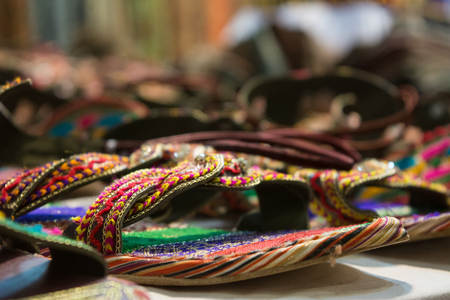sale of colored sandals at the african shop on blur background Stock Photo