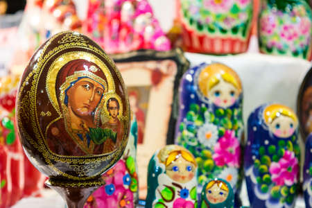 catholic russian egg souvenir at the russian shop on blur Matryoshkas background