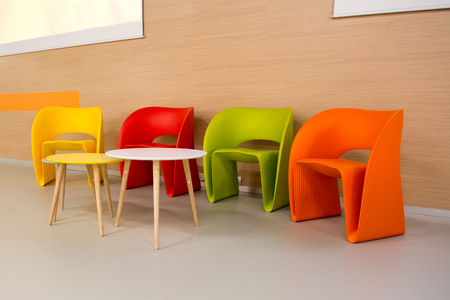 colored modern chairs in a row neatly into a waiting room