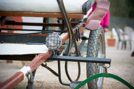 close up of an old horse handcart on blur background