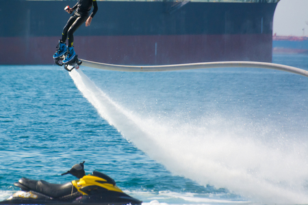 ionian: flyboard show in the ionian sea on blur background