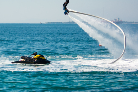 flyboard show in the ionian sea on blur background