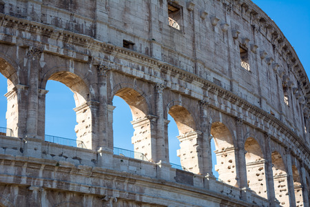 view of the colosseum in rome on blue sky background