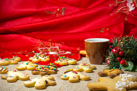 Italian Homemade Traditional Biscuits Without Butter Near A Cup Of Espresso Cofee And A Christmas Pine Cone