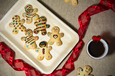 Italian Homemade Traditional Biscuits Without Butter Near A Cup Of Espresso Cofee And A Red Christmas Ribbon Stock Photo