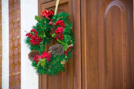 Christmas Decoration On a Wooden Door in Italy Stock Photo