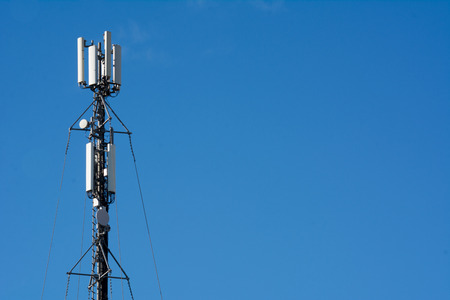 Close Up Of A Cellphone Digital Tower On Blue Sky Background Stock Photo