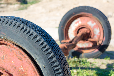 Two wheels composition made by a close up of an old tire on blur tire background