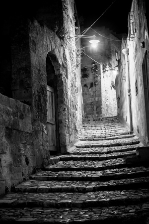 Alley At Night Illuminated By Artificial Light In The City Of Matera In the South Of Italy Stock Photo