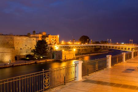 Taranto swing bridge on the Taranto canal boat illuminated by lights at night