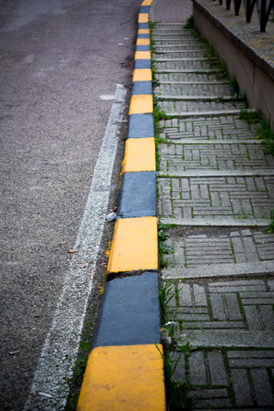 Vertical View Of a Stoned Stair Along The Street With Black and Yellow Markings. Matera, South of Italy