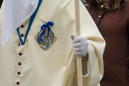 Close up of a Man Dressing Ritual Traditional Dress during a Catholic Celebration