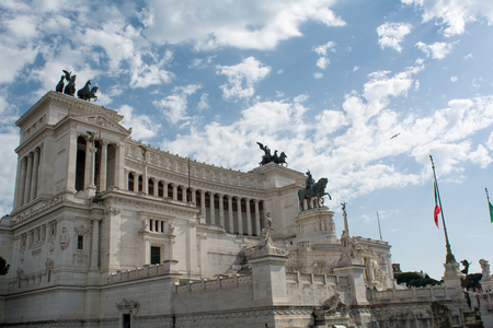 Horizontal View of the Altar of the Fatherland on Blue Partially Cloudy Sky Background. Rome, Italy