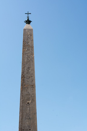 Vertical View of the Lateranense Obelisk on Blue Sky Background Stock Photo