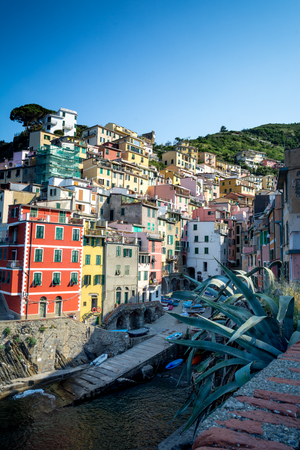 Vertical View of the Town of Riomaggiore on Blue Sky Background. Italy, National Park of the Cinque Terre