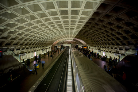 Horizontal View of The Washington Underground With one Running Train and a Empty Rail on Blur Background