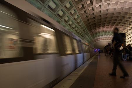 Blur Shape of a Man Walking Towards a Running Metro Train in the Washington Underground on Blur Background 스톡 콘텐츠