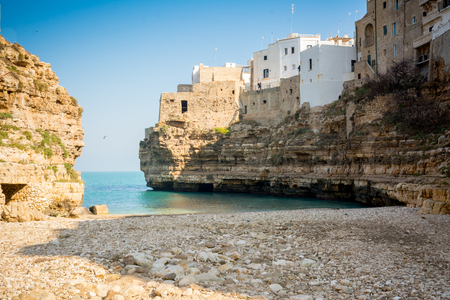The Bay of Polignano a Mare Built on the Cliff near Bari, in Italy, on Blue Sky Background