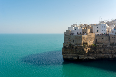 The City of Polignano a mare Built on the Cliff near Bari, in Italy, on Blue Sky Background