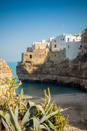 The Bay of Polignano a Mare Built on the Cliff near Bari, in Italy, on Blue Sky Background Reklamní fotografie - 119913509