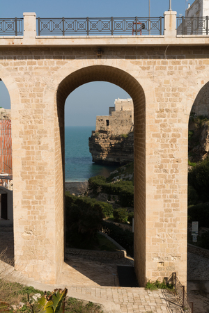 The Bridge in front of The Bay of Polignano a Mare Built on the Cliff near Bari, in Italy, on Blue Sky Background Imagens