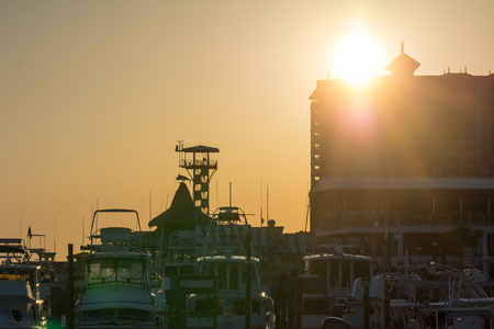 Sun At Sunset and Cityscape in a Torrid Day. Destin Beach, Florida