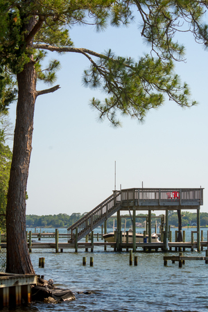 Panoramic View of Boat Lift in a Lake on Blur Background. Niceville, Florida Фото со стока