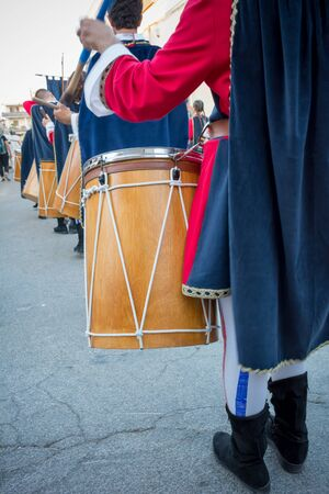 Close Up of Man Playing Drum at Medieval Village Festival on Blur Background Stock fotó
