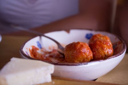 Close Up of Italian Traditional Food Called Polpette col Sugo, Made with Cheese, Meat and Tomato on Blurred Background Stock Photo