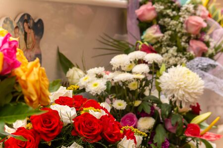 Fresh Flowers Deposed in the Day of Commemoration of the Dead on Blurred Background