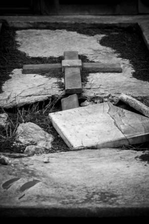 Broken Tomb in Italian Cemetery on Blurred Background