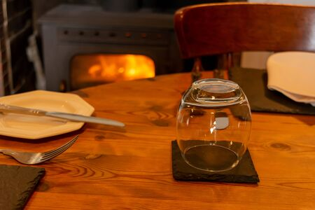 Set Table for Breackfast in English Cottage in Countryside on Blurred Wood Burning Stove on Background