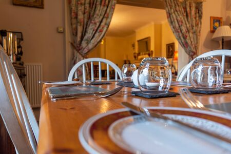 Set Table for Breackfast in English Cottage in Countryside on Blurred Background
