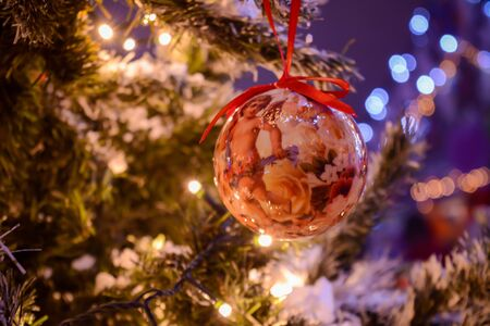 Christmas Decorations on a Christmas Tree on Blurred Background
