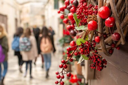 Christmas Decorations in a street during Christmas Period in Matera, Italy, on blurred background 版權商用圖片 - 136015704
