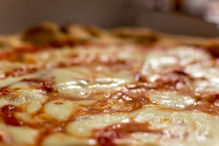 Close Up of Italian Pizza Margherita with Mozzarella and Tomato on Blurred Background 版權商用圖片 - 136015833