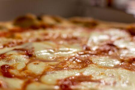 Close Up of Italian Pizza Margherita with Mozzarella and Tomato on Blurred Background 版權商用圖片