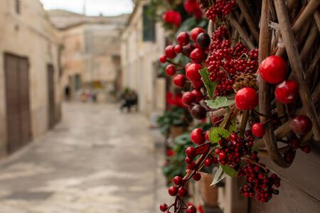 Christmas Decorations in a street during Christmas Period in Matera, Italy, on blurred background 版權商用圖片 - 136015772