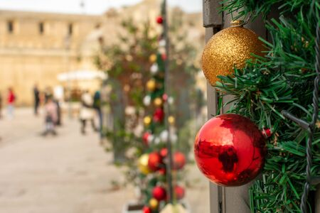 Christmas Decorations in a street during Christmas Period in Matera, Italy, on blurred background