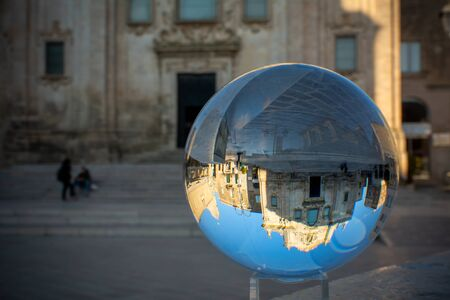 The Church of San Francesco Di Assisi in Matera enclosed in a Cristal Sphere on Blue Sky Background 版權商用圖片 - 137728779