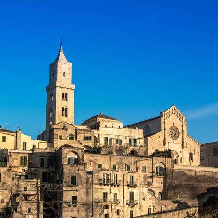 The Cathedral of Matera in the Middle of the Sassi di Matera on Blue Sky Background 版權商用圖片 - 137730894