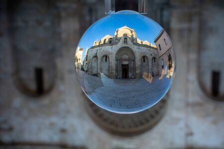 The Church of San Giovanni Battista enclosed in a Cristal Sphere on Blue Sky Background 版權商用圖片
